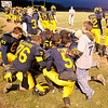 Players kneel to pray as Shenandoah faced Heritage Christian in the sectional final at Shenandoah on Friday.