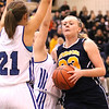 Photo by Chris Martin   <br /> Morgan Tapscott drives to the bucket against Tipton defenders during Saturday's Regional Semifinal game.