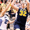 Photo by Chris Martin<br /> Rachel Krathwohl shoots a layup defended by Tipton's Taylor Weddell during Shenandoah's Regional Semifinal game on Saturday.