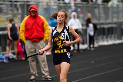 "Ken Kadwell/@KenKadwell - Special to the Sun Shepherd freshman Katelyn Hutchinson hands off her baton after finishing the four by 800 relay at the Shepherd invitational Friday, May 2, 2014.  ""I am proud of my team they worked hard,"" said Hutchinson after placing first."