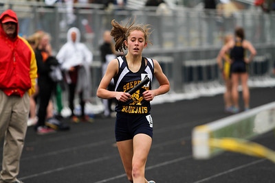 "Ken Kadwell/@KenKadwell - Special to the Sun Shepherd freshman Katelyn Hutchinson completes the four by 800 relay at the Shepherd invitational Friday, May 2, 2014.  ""I am proud of my team they worked hard,"" said Hutchinson after placing first."