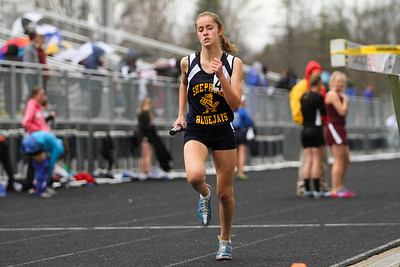 "Ken Kadwell/@KenKadwell - Special to the Sun Shepherd freshman Katelyn Hutchinson competes in the four by 800 relay at the Shepherd invitational Friday, May 2, 2014.  ""I am proud of my team they worked hard,"" said Hutchinson after placing first."