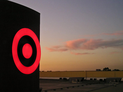 Target's bright red bullseye shoots pink clouds across the sky. (From top level of Oakridge Shopping Center parking garage.)