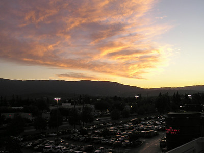 Looking east across the south parking lot, the bright red lights of Cheescake Factory beckon. (From top level of Oakridge Shopping Center parking garage.)
