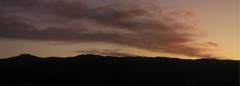And as Mount Umunhum sinks slowly in the south (tiny tower on mountain to the left)-- (From top level of Oakridge Shopping Center parking garage.)