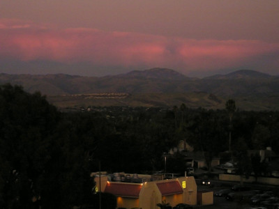 The sky behind Lick Observatory atop Mount Hamilton really lit up for a grand finale. Looking across the shopping across the way. (From top level of Oakridge Shopping Center parking garage.)