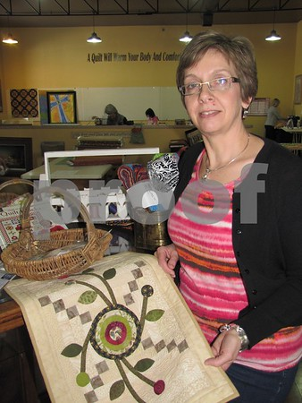 Jo Seltz, owner of 'Tillies Quilts', shows a small appliqued project she used for demonstration for a class.  The store offers many quilting classes.