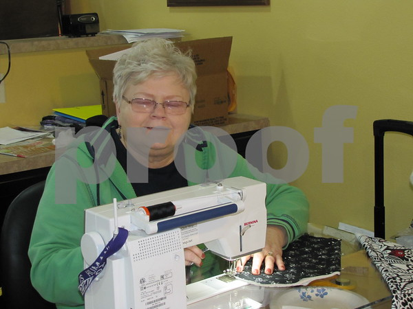 Diane Lehman working on a project in the sewing room at 'Tillies Quilts'.  Lehman has several beautiful, completed projects on display in the store.