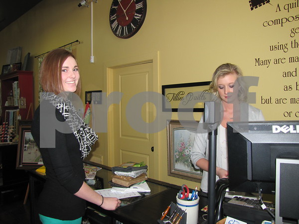 Sigourney Seltz rings up a purchase for Hannah Peterson at 'Tillies Quilts' in downtown Fort Dodge.