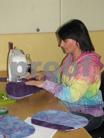 Skeeter Fuller is shown working on her project in the sewing area at 'Tillies Quilts' during Sister Saturday.