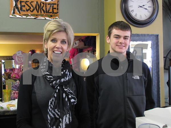 Jill Bush, owner of 'Xessorize' with her son Alex.  The store features jewelry, scarves, purses, and more.