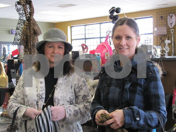 Carolyn Davis and Justine Lee shopping at 'Xessorize' in downtown Fort Dodge.