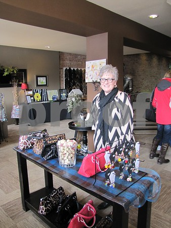 Shari Burke, owner of 'Studio Fusion' in the showroom of  merchandise that is offered in addition to the glass fusion studio.  She offers many classes as well as individual instruction for that one of a kind gift.