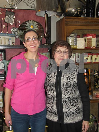 Mary Kay Daniel, owner of 'Mary Kay's Gifts and Interiors' and her mother, Margo Daniel pose between helping customers at the Sister Saturday event.