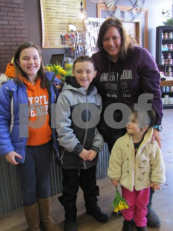 Casey Miller with her children Gracie, Drayton, and Brogan enjoy shopping together at Real Deals.