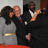 "Amber Hankins takes a photo of her mom Tiffany Dawson with Bill Rasmussen<br /> Founder of ESPN and Author of  ""Sports Junkies Rejoice: The Birth of ESPN"" who was at a book signing party at the Philadelphia law offices of Zarwin, Baum, DeVito, Kaplan, Schaer & Toddy, P.C; Photo taken 2/10/11  (That's former Philadelphia Eagles player Mike Quick on the far right)"