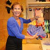 Founder and chief fit stylist of {intimacy} Susan Nethero poses with a few bras in the Plaza at King of Prussia, Friday. Already a well-known chain, {intimacy} will host a grand opening Monday for its new store inside the mall.