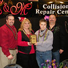 Chamber President Shane Frye with Best Booth in Show - Small Business winners from C&M Collision Repair Center.