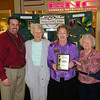 Chamber President Shane Frye with Best Booth in Show - Large Business winners from Green Country Village.
