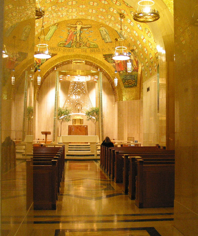 This is the Blessed Sacrament chapel. The tabernacle in the middle is shaped like the Ark of the Covenant. The canopy above it has small squares meant to represent manna.