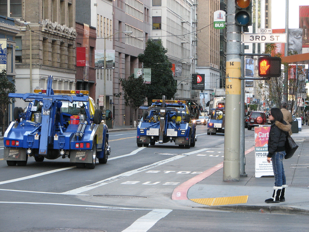 2007 01 12 Fri - SF downtown financial district rush hour - Army of tow trucks led by meter maid