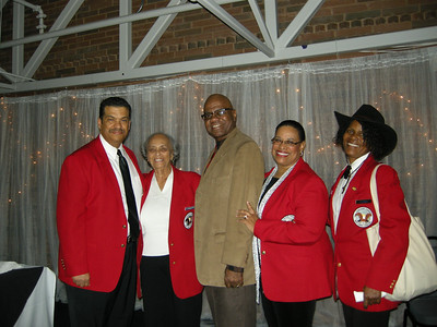 Members of the East Coast Chapter Tuskegee Airmen attend the Silent Auction & Gala at College Park Aviation Museum
