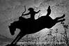 A cowboy on a bucking bronc