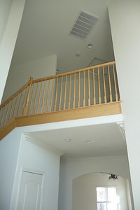 Open staircase in the vaulted entry