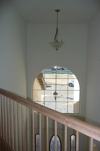 Palladium window in vaulted front hall from upstairs
