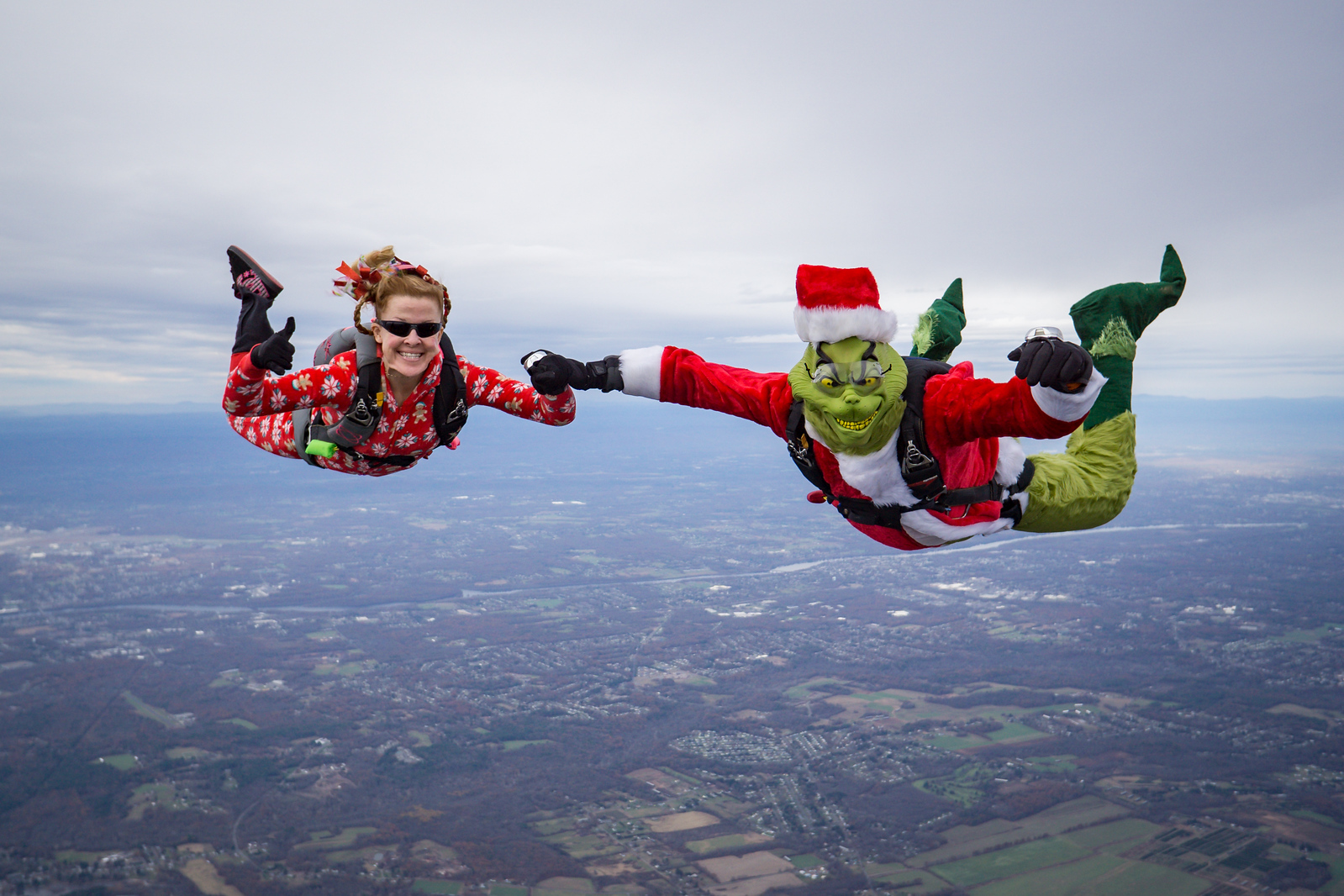 """Cindy and the Grinch. <br><span class=""""skyfilename"""" style=""""font-size:14px"""">2017-11-18_skydive_cpi_0051</span>"""