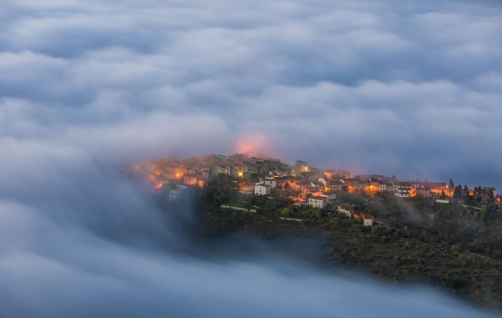 Castelvecchio Calvisio in morning clouds.
