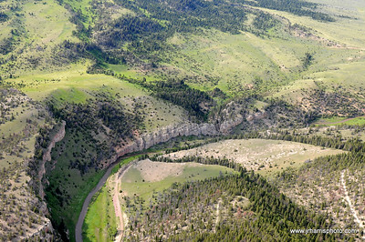 Aerial view of Milwaukee Road abandoned located along the main line between Harlowton and Three Forks Montana along Sixteen Mile Creek. Photography by Jim R. Harris Bozeman Montana aerial photography 2011