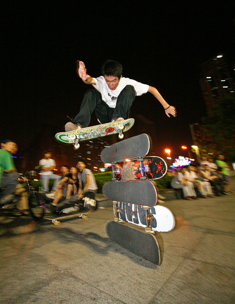 "Howard Li clears 5 skateboards in Litchi Park, the ""skateboarding Eden"" of Shenzhen."