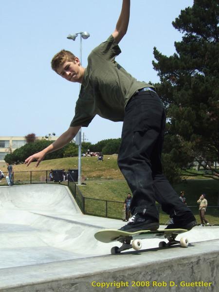 50-50 grind on vert ramp. Potrero del Sol Skatepark. Potrero Ave. and 25th St., Potrero Hill District, San Francisco, California.