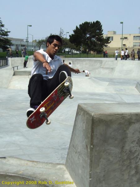 Air between pipe and vert ramp. Potrero del Sol Skatepark. Potrero Ave. and 25th St., Potrero Hill District, San Francisco, California.