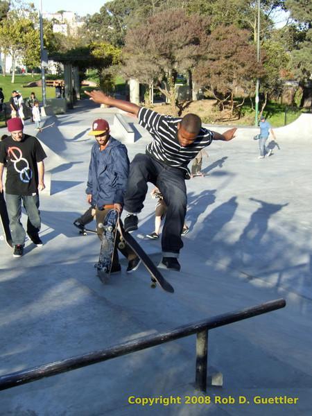 Flip tricks on street course. Potrero del Sol skatepark, Potrero Ave. and 25th St., Potrero Hill District, San Francisco, California.