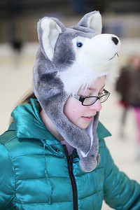 03Feb13___Samantha Gottschling, age 11, of Elyria, is warm in her wolf hat while skating at North Park Ice Rink in Elyria. photo by Ray Riedel