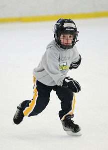 03Feb13___Peyton Taylor, age 6, of Lorain, zips along perfecting his skills for hockey at North Park Ice Rink in Elyria. photo by Ray Riedel