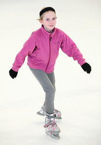 03Feb13___Kiley Waterbury, age 10, of Amherst, enjoys the ice at North Park Ice Rink in Elyria. photo by Ray Riedel
