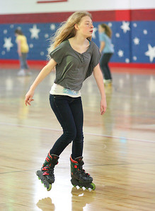 17Mar2013__ Halle Borer, age 13, from South Amherst, zips by at Country Skateland. photo by Ray Riedel