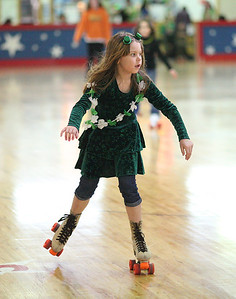 17Mar2013__ Trena Emery , age 7, of Elyria, celebrates St. Patrick's Day at Country Skateland in Oberlin. photo by Ray Riedel