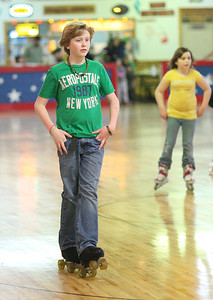 17Mar2013__ Josh Kelly, age 12, is cool as he glides by wearing the green for St. Patrick's Day at Country Skateland in Oberlin. photo by Ray Riedel