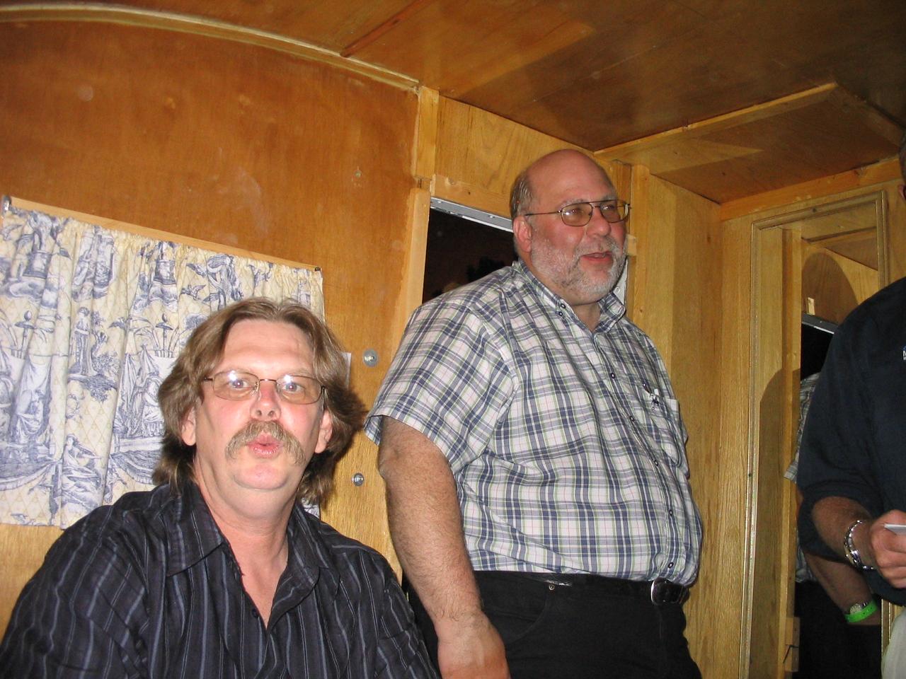 Joe Denton, the web master, with Mike Kneebone looking on.