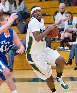 Skidmore's Sakhile Sithole drives around Hartwick defender Jon Zehe during Tuesday game at Skidmore. Ed Burke 11/29/10
