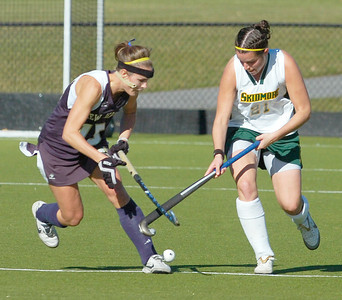 Skidmore's Lauren McCarthy battles with The College of New Jersey's Alex Okuniewicz  during Saturday's NCAA Divison III field hockey semifinal. Ed Burke 11/13/10