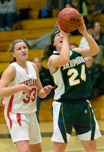Skidmore's Jessie Kavana looks for two after getting past Cortland's Mary Bruns during Saturday's 33rd Annual Skidmore College Women's Invitational Toyrnament. Ed Burke 11/20/10