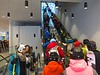 Escalators carry skiers up to the main level, where they catch the main tram.
