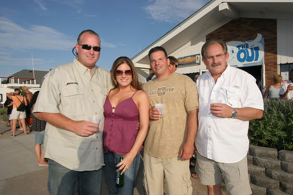 Scott Leonard of Augie's Custom Tackle and his wife Nicole, Frankie and Pete.