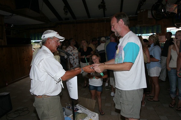 Bill Lawton Receiving a $50 gift Certificate for Auggie's bait and Tackle
