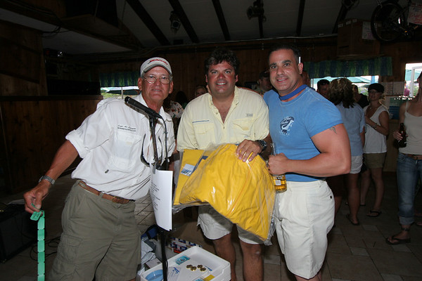 Captain Al, Tim Smith and the winner of the Old Harbor Outfitters foul weather gear, Kevin Conzone.